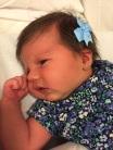 Catarina e seu novo brinquinho colocado pela equipe Personal Mamãe Bebê, 9 dias.